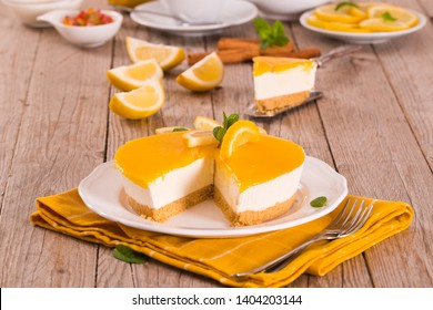 Lemon and mascarpone cheesecake on white dish.