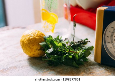 Lemon and mint on a table at cozy home