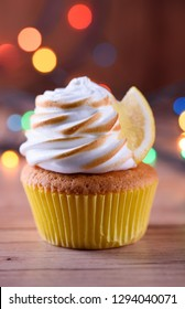 Lemon muffins with protein cream and beautiful lights in a dark key