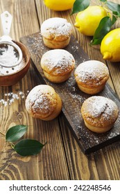 Lemon muffins with sugar powder on the wooden table