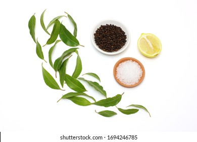 Lemon Myrtle, Peppercorns, Lemon and Salt on White Background