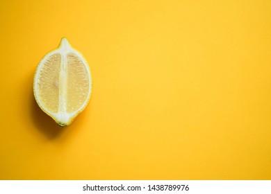 Lemon on colored backgrounds, cut lemon on colored backgrounds, pink yellow backgrounds