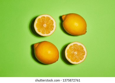 Lemon on green background. Flat lay, top view, copy space . Food concept.