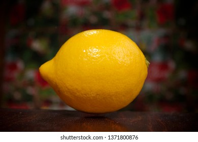 Lemon on a wooden table with colorful background