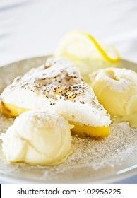 Lemon Pie with ice cream on plate