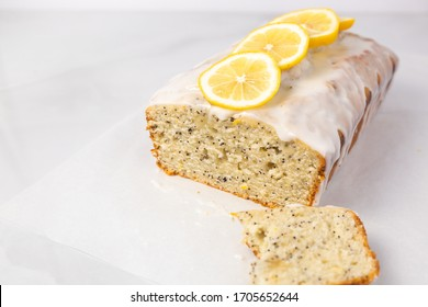 Lemon poppy seed loaf with eaten slice cut out
