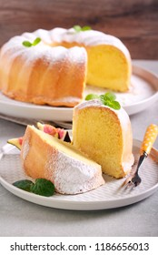 Lemon ring cake with icing sugar served on plate