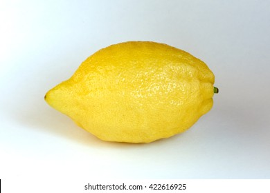 Lemon ripe and unpeeled on white background.