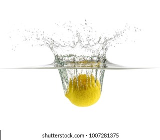 Lemon slice drop in fizzy sparkling water, juice refreshment