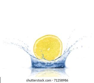 Lemon slice dropped into water, isolated on white background