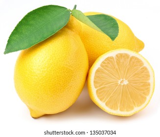 Lemon with lemon slice and leaves isolated on a white background.