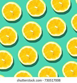 Lemon slice pattern on pastel background. Minimal fruit concept.