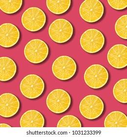 Lemon slices pattern on vibrant pomegranate color background. Minimal flat lay food texture