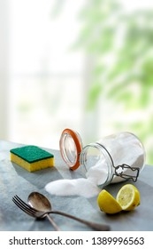 Lemon and sodium bicarbonate. Eco-friendly natural cleaners baking soda, lemon on wooden table