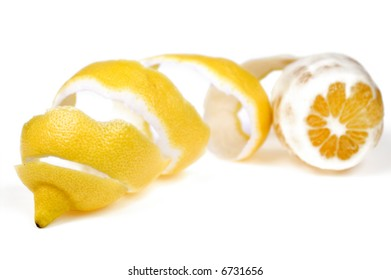 Lemon with spiral peel isolated on white background