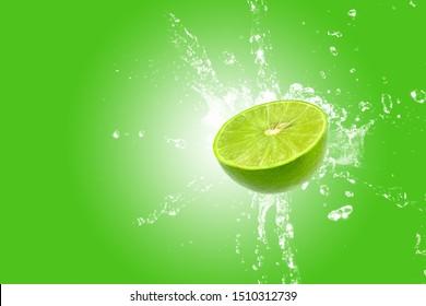 Lemon splash on green background. Green lime splashing.