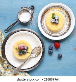 Lemon Sponge Custard cake served with berries on plate