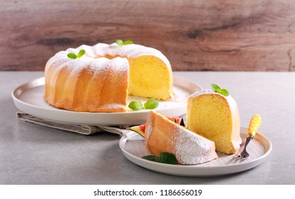 Lemon sponge ring cake with icing sugar on plate