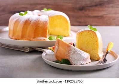 Lemon sponge ring cake with icing sugar on plate