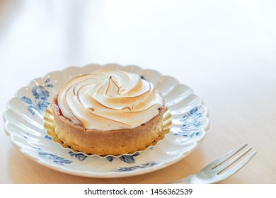 Lemon tart meringue in vintage plate
