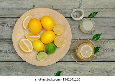 lemon tea with lemon and lime on wooden table