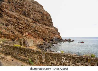 LEMON VALLEY, SAINT HELENA/UK - 02/2018: view of Lemon Valley Bay and part the defensive walls. The fortification is more than 300 years old, it was also used for quarantine purposes for the slaves.