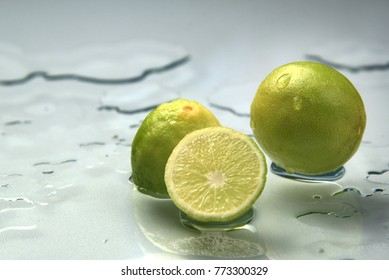Lemon with water droplets, shot in ambient natural lighting.