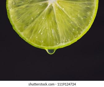 lemon and waterdrop, black background