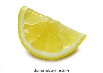 Lemon wedge isolated on white