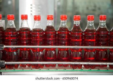 Lemonade in bottles on the conveyor