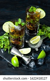 Lemonade or  Cuba libre cocktail with cola, rum,  lime and mint, cold refreshing drink or beverage with ice