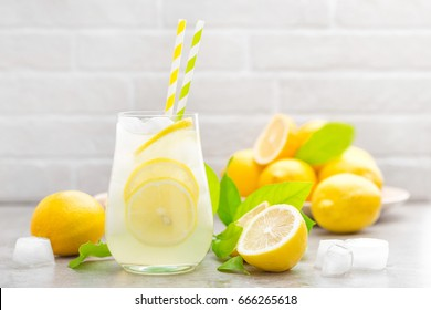 Lemonade. Drink with fresh lemons. Lemon cocktail with juice and ice.