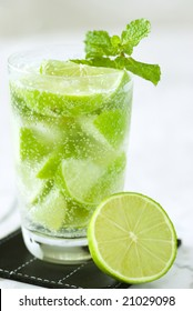 Lemonade drink with mint over table