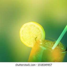 Lemonade with fresh lemon on  background