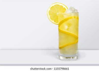 Lemonade with fresh lemon on desk