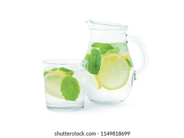 Lemonade with fresh lemon. Lemon water. Homemade lemonade with citruses. Isolated on white background. Drink with fresh lemons. Tasty cool beverage with lemon and mint