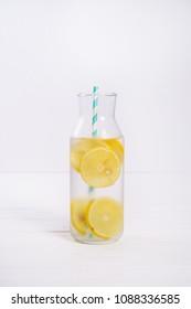 lemonade in a glass bottle on white wood