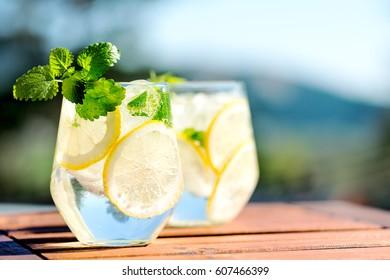 Lemonade in glass on wooden table