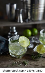lemonade in glass with rosemary.