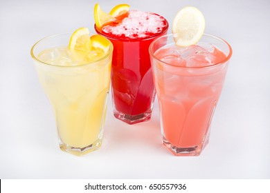 Lemonade glasses served on a white background