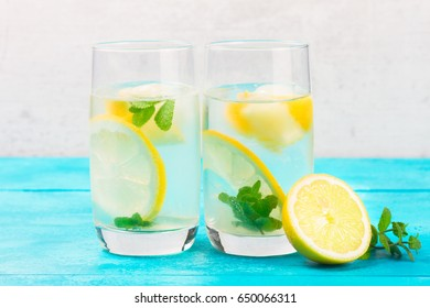 Lemonade homemade drink - two glasses with ice and mint