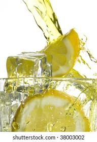 Lemonade and ice. Splashing drink
