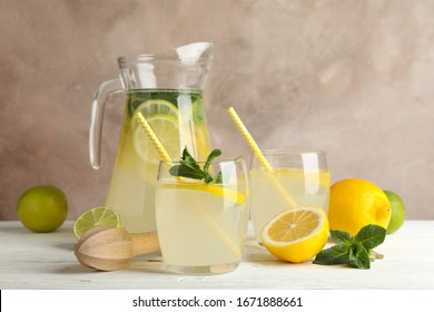 Lemonade and ingredients on wooden table. Fresh drink
