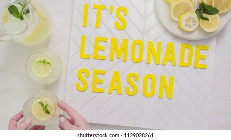 it's lemonade season wood sign with glass of fresh lemonade.