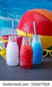 lemonade slush, blueberry slush and strawberry slush. patriotic cool drinks for your 4th of July picnic or at the beach