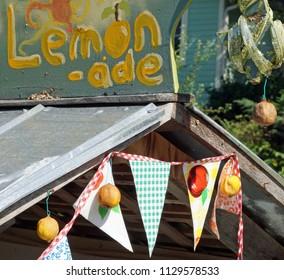 Lemonade stand decorated on city sidestreet