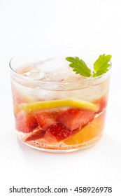 lemonade with strawberry and lemon on a white background, closeup, vertical