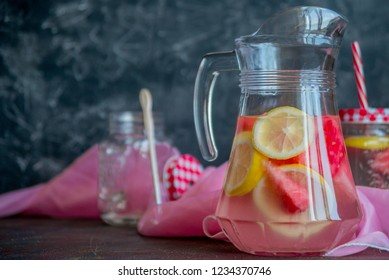Lemonade watermelon and lemon in a glass carafe. The concept of a refreshing drink in the summer.