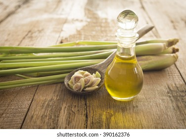 Lemongrass essential oils placed on a wooden table. spa concept.