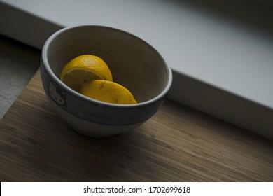 Lemons in bowl near window